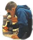 Junior Naturalist looking at microscope